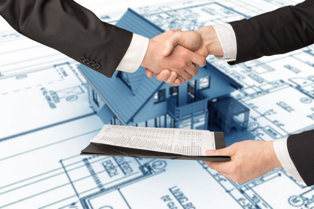 People shaking hand in a real estate transaction
